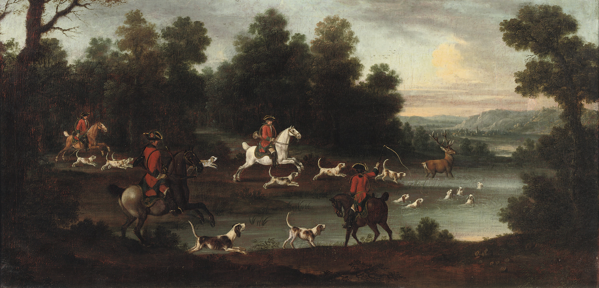 An extensive wooded river landscape with a hunting party pursuing a deer