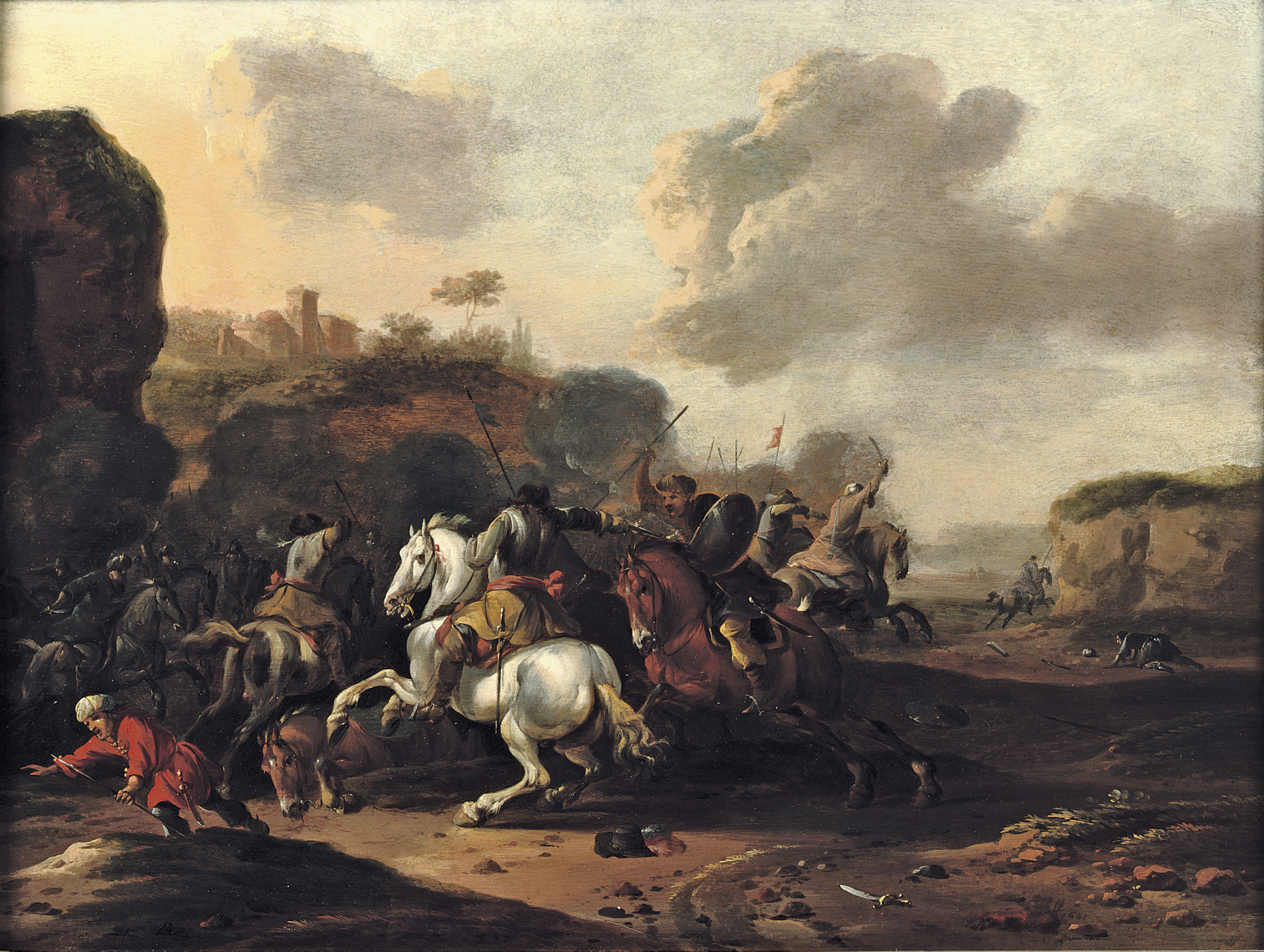 A cavalry skirmish in a rocky Italianate landscape