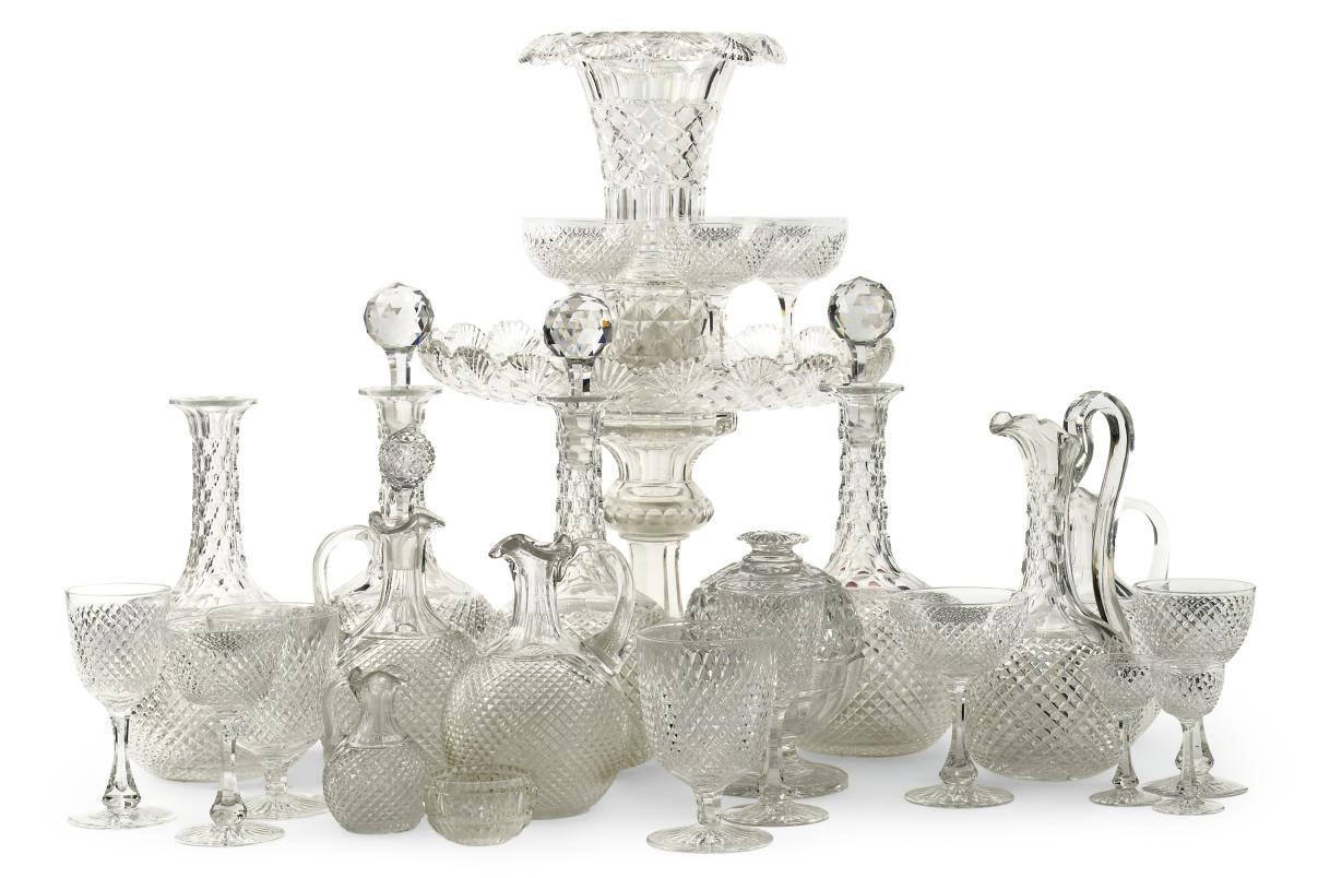 AN EXTENSIVE CUT-GLASS TABLE S