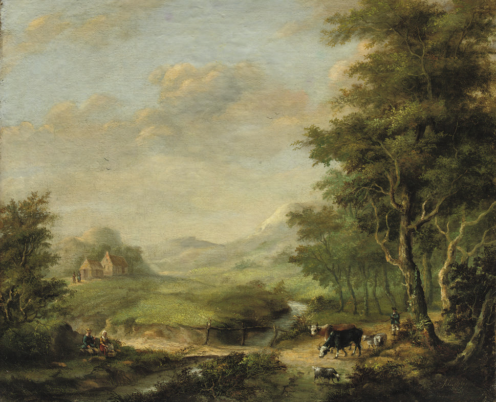 Cattle in a wooded landscape