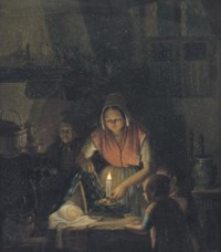 Admiring the newborn by candlelight