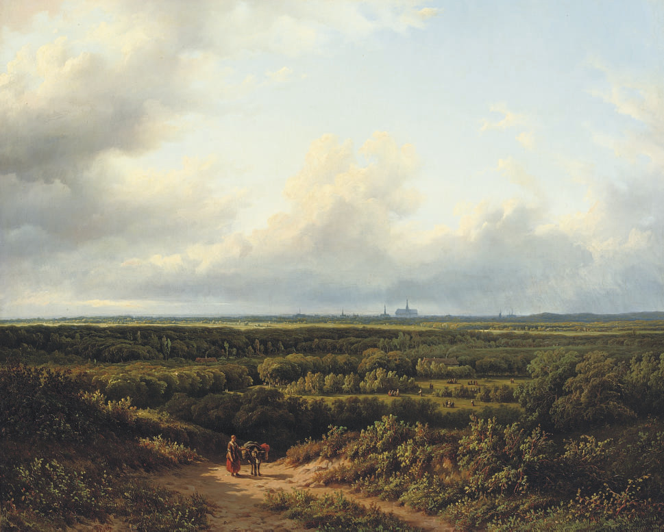 Figures in an extensive summer landscape with Haarlem in the distance