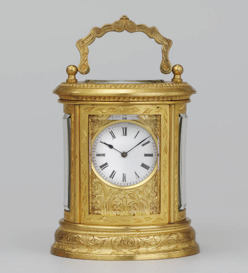 A French miniature engraved gilt-brass eight day carriage timepiece