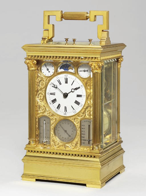 A fine French brass grande sonnerie eight-day carriage clock with full calendar, moonphase, barometer and thermometer, Victorien Boseet, No.613. circa 1880. 7½ in (19 cm) high, handle down. Sold for £36,500 on 20 February 2008 at Christie's in London