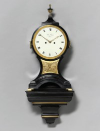 A George III ebonised and brass-mounted striking eight day bracket clock on wall bracket