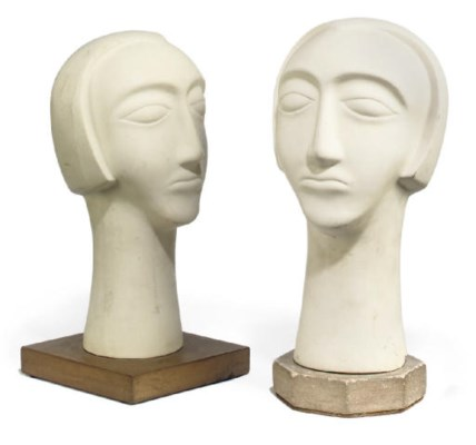 TWO PLASTER HEADS OF WOMEN