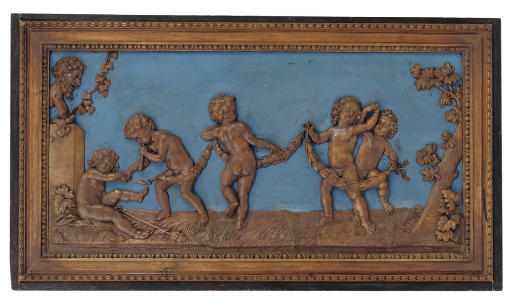 A FLEMISH CARVED WALNUT AND BL