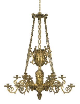 A WILLIAM IV GILT-BRASS TWELVE