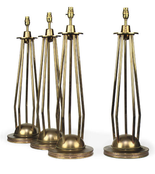 A SET OF FOUR BRASS TABLE LAMPS