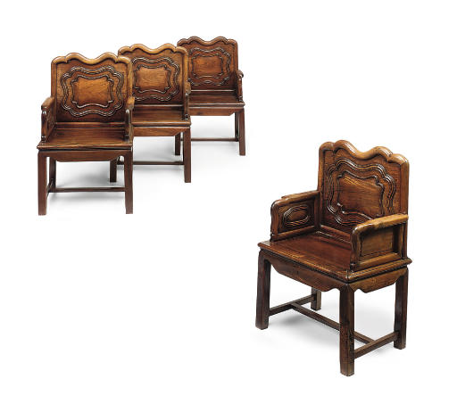 A SET OF FOUR CHINESE HARDWOOD/HUANGHUALI ARMCHAIRS