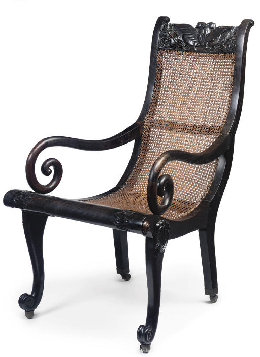 AN ANGLO-INDIAN EBONY OPEN ARMCHAIR