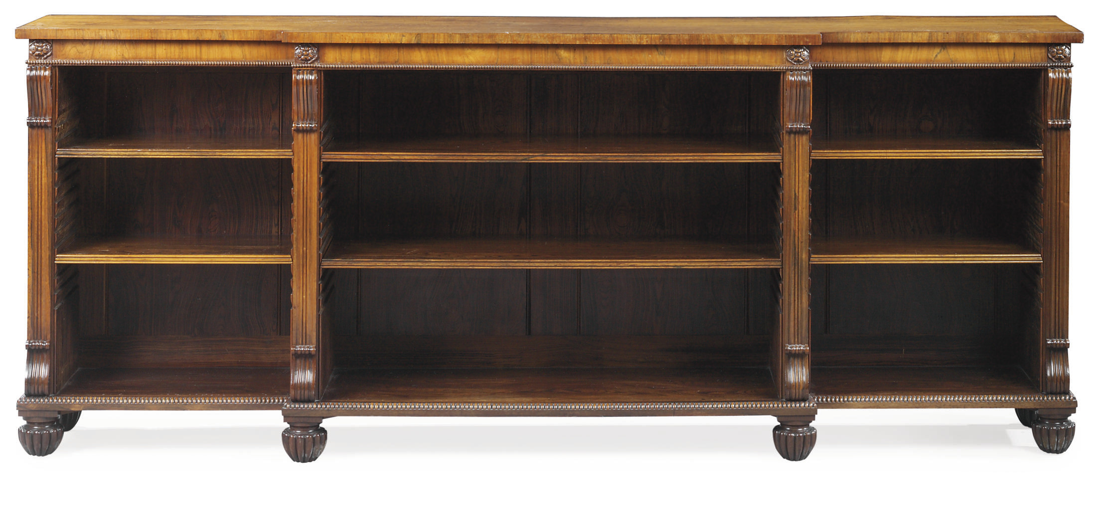 A REGENCY ROSEWOOD BREAKFRONT BOOKCASE