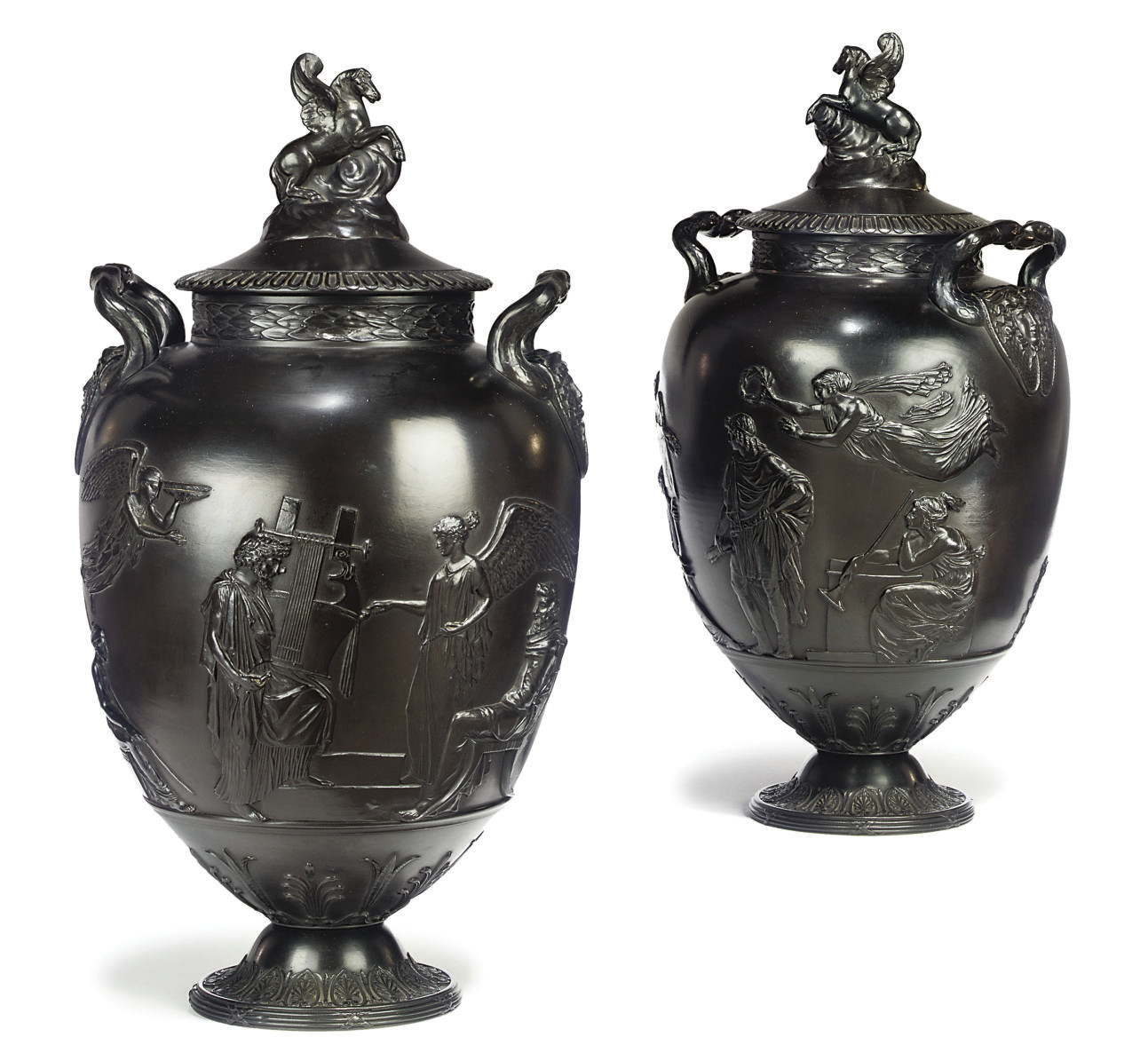 A PAIR OF WEDGWOOD BLACK BASALT 'PEGASUS' VASES AND COVERS
