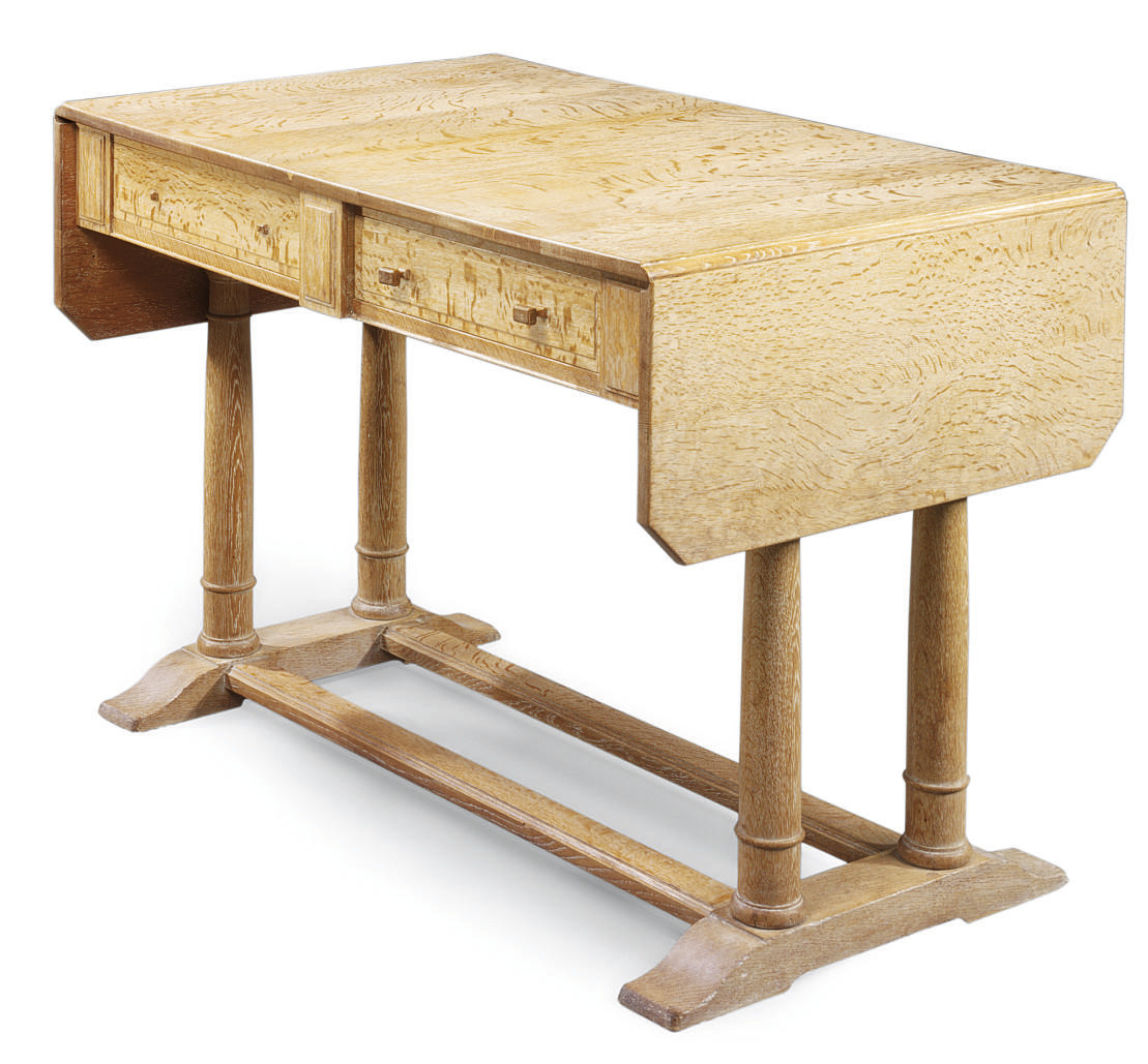 A HEAL'S LIMED OAK WRITING TABLE , DESIGNED BY SIR AMBROSE