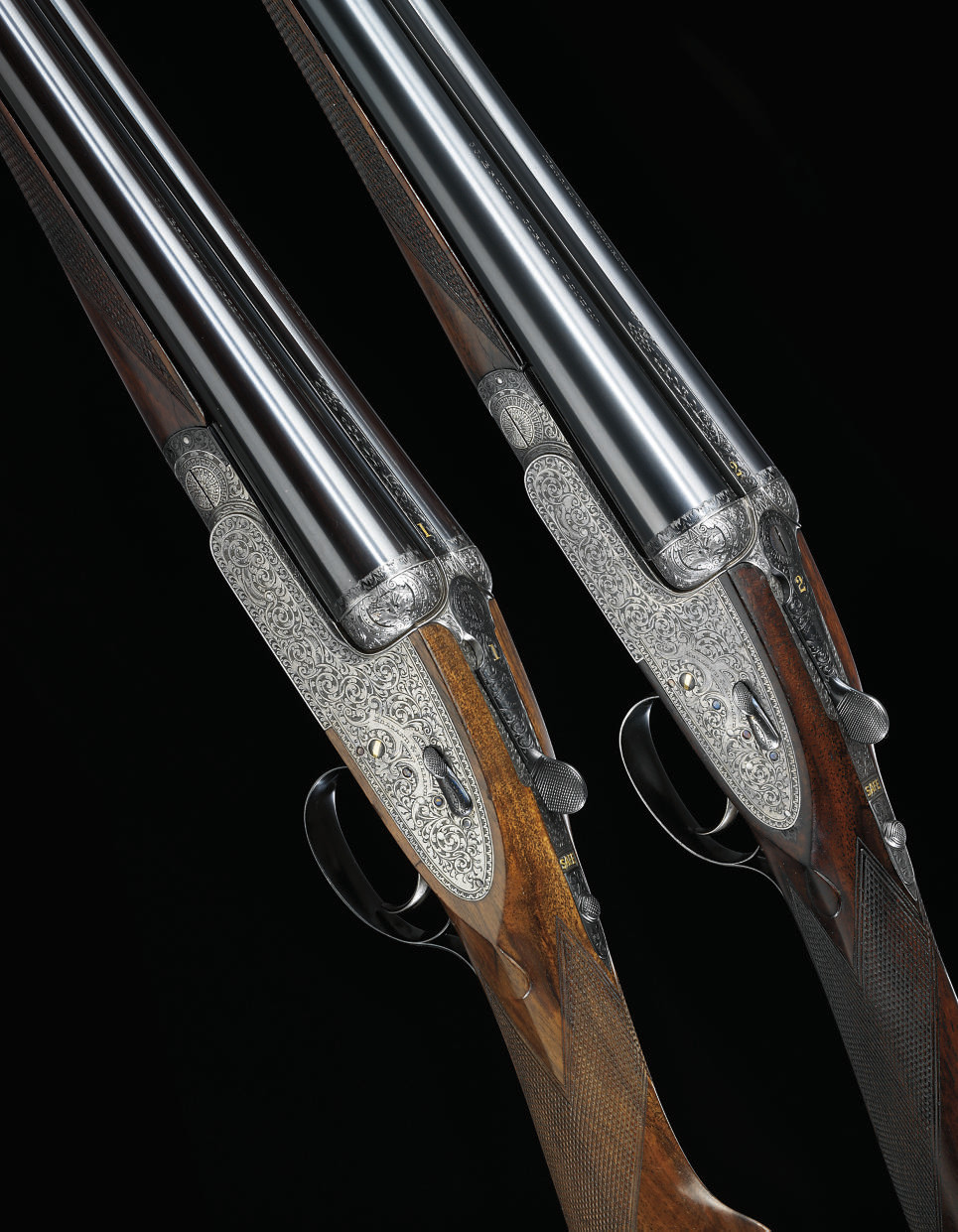 A PAIR OF 20-BORE 'ROYAL' MODEL SIDELOCK EJECTOR GUNS BY HOLLAND & HOLLAND, NOS. 27017 & 27902