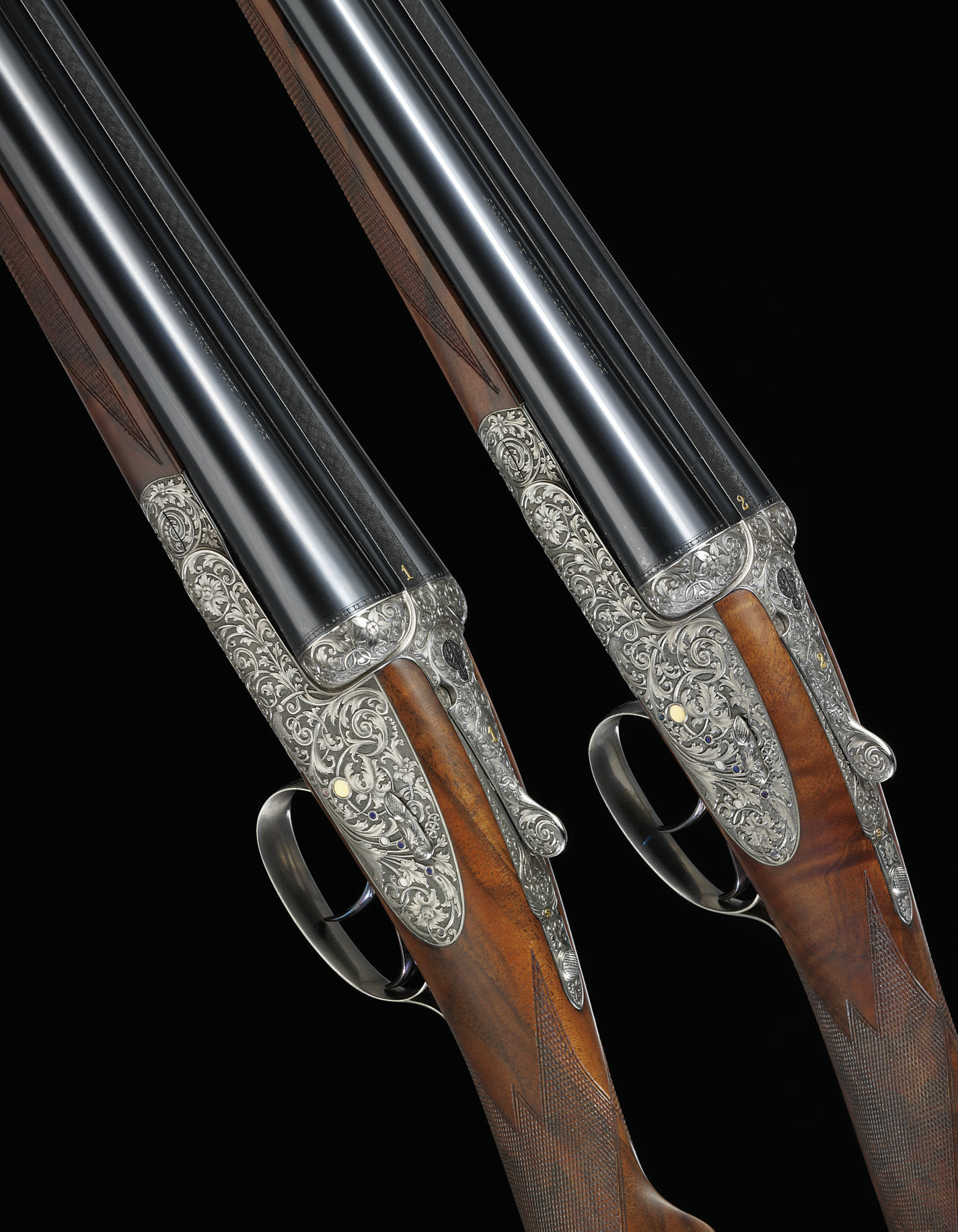 AN EXCEPTIONALLY FINE PAIR OF 12-BORE LOVENBERG ENGRAVED SIDELOCK EJECTOR GUNS BY LEBEAU COURALLY, NOS. 45329 30