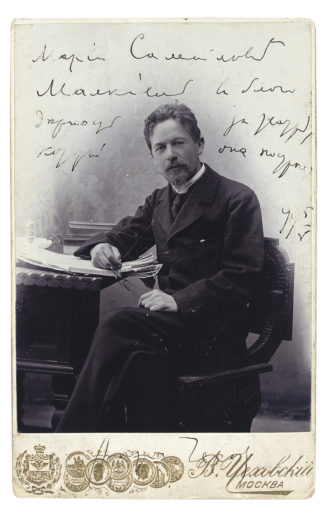 CHEKHOV, Anton Pavlovich (1860-1904) -- A photographic portrait of Chekhov, inscribed by the author to Mariia Samoilovna Malkiel, on the image and signed in the mount, 5 May 1889.