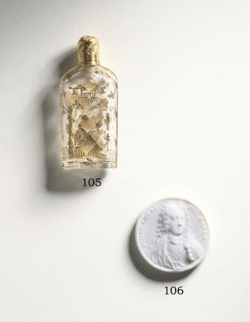 A FACETED GLASS SCENT BOTTLE,