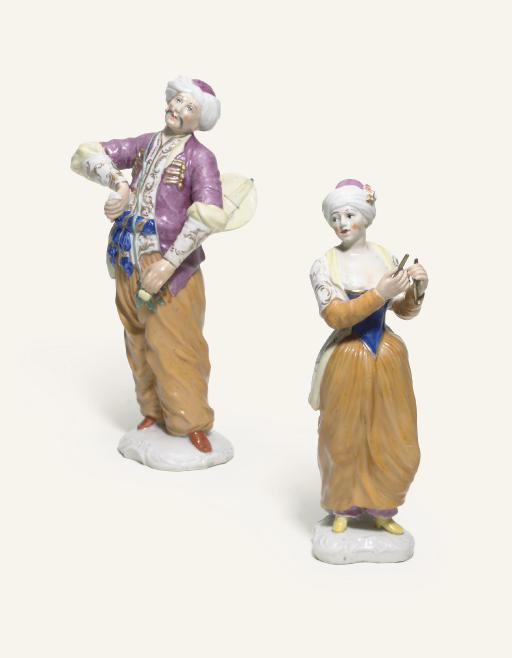 A PAIR OF KLOSTER-VEILSDORF FIGURES OF A TURKISH MUSICIAN AND COMPANION