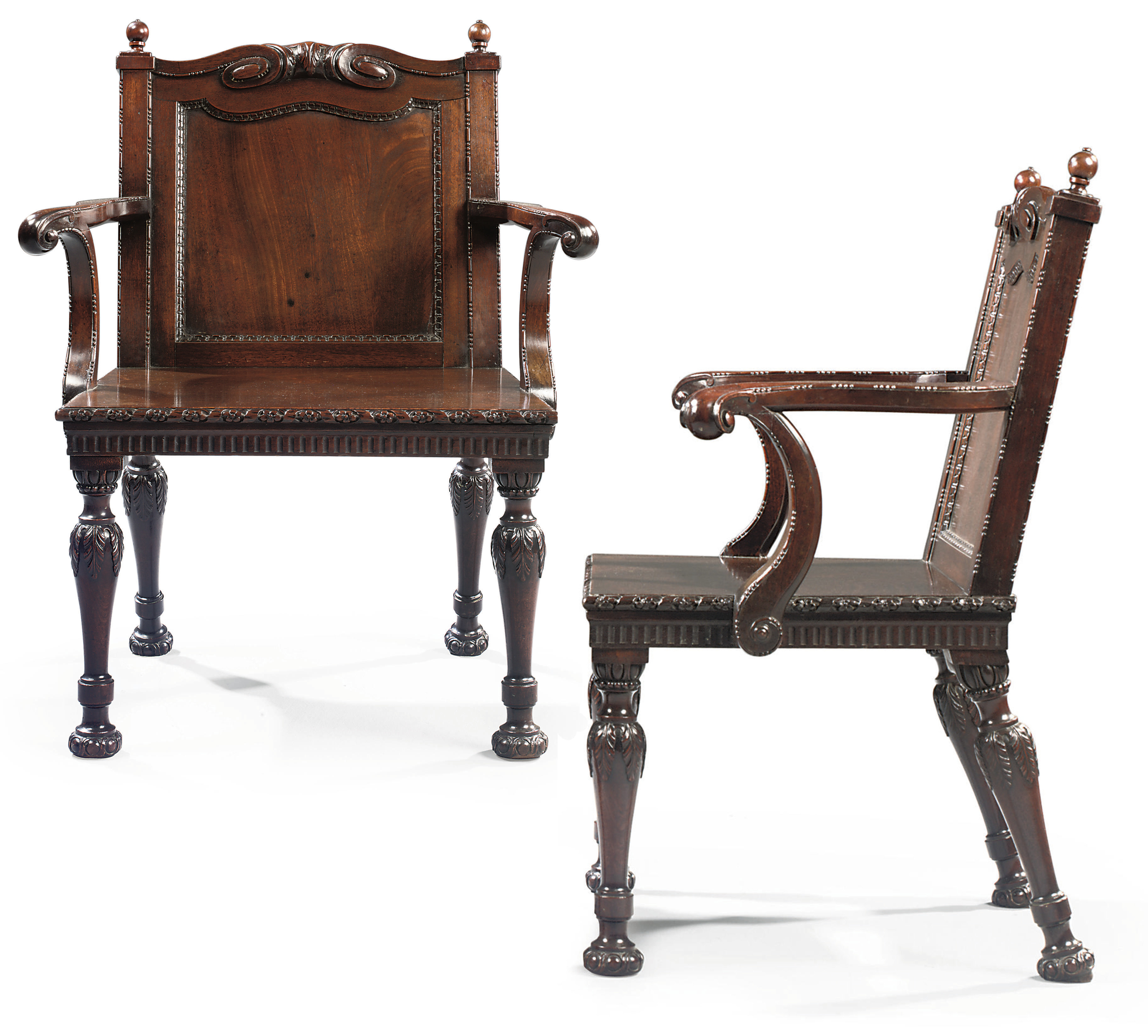 A PAIR OF EARLY GEORGE III MAHOGANY HALL CHAIRS