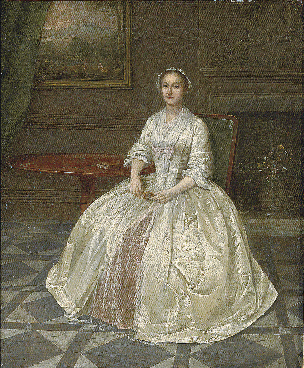 Portrait of a lady, small full-length, in a white dress with pink underskirt, seated beside a mahogany tripod table, a fireplace with a stucco overmantel beyond