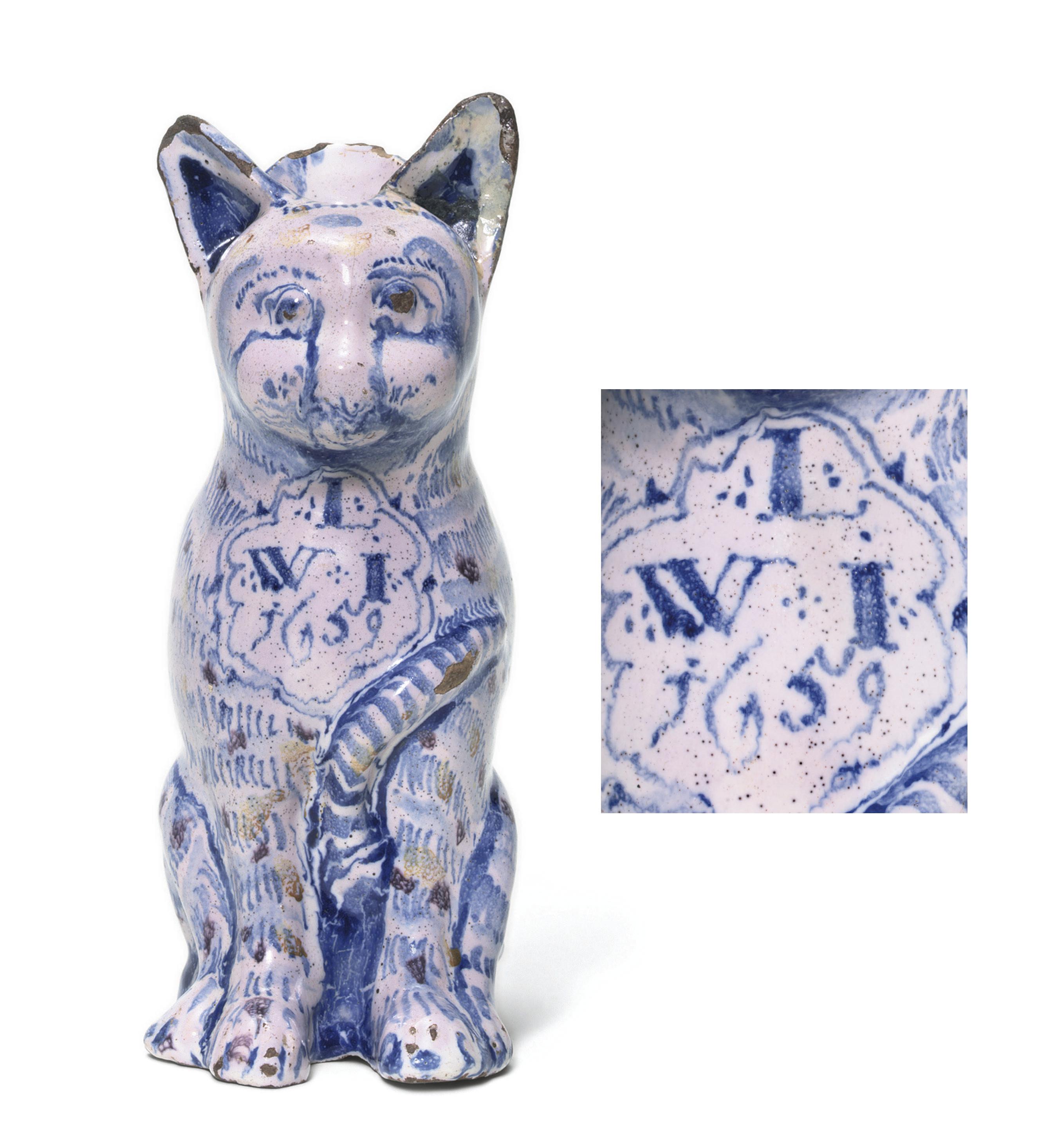 A LONDON DELFT DATED CAT JUG