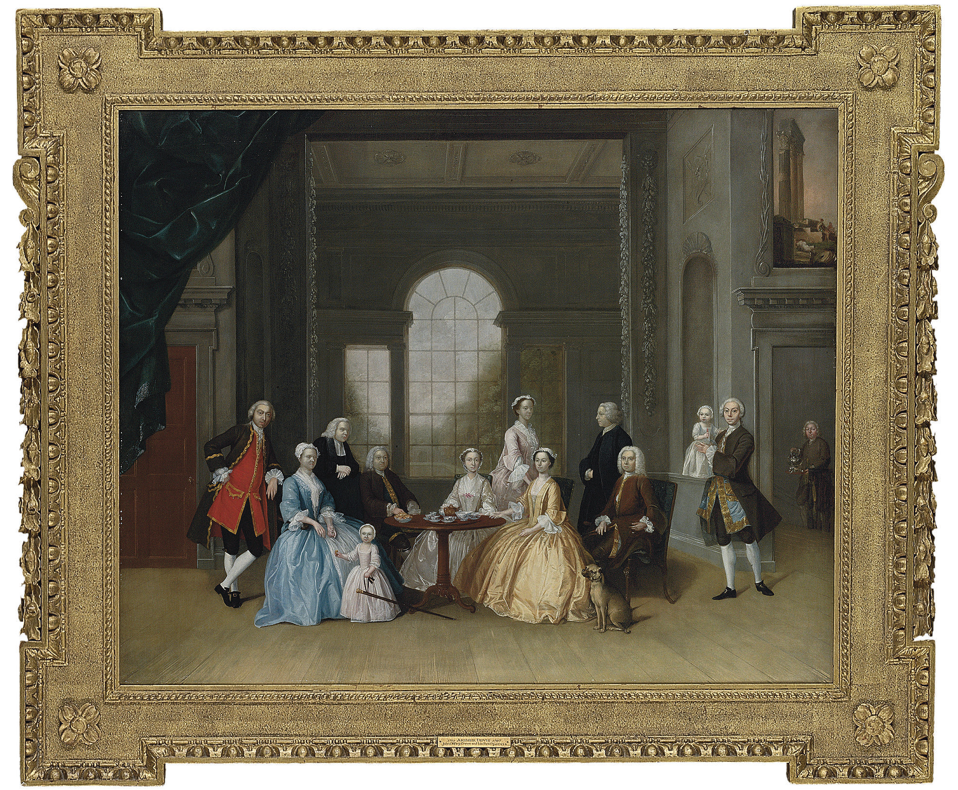 Group Portrait of John Offley Crewe and his family, taking tea around a tripod table in an interior, with a servant with a silver hot water- kettle and heater climbing the stairs to the room, a Venetian window overlooking a garden with a pond beyond
