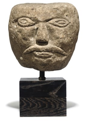 A CARVED STONE FRAGMENTED HEAD