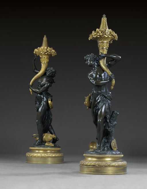 A PAIR OF FRENCH ORMOLU AND PATINATED BRONZE TORCHERES