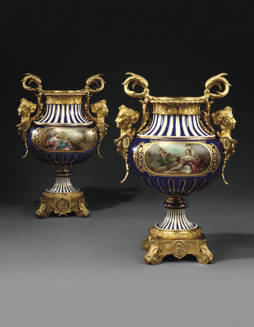 A PAIR OF FRENCH ORMOLU-MOUNTED SEVRES STYLE COBALT-BLUE GROUND VASES
