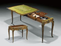 A FINE AND RARE FRENCH ORMOLU-MOUNTED TULIPWOOD, MAHOGANY AND MARQUETRY EXTENDING GAMES-TABLE