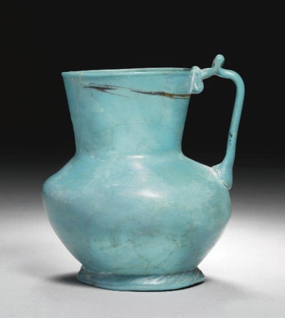 AN OPAQUE TURQUOISE GLASS JUG