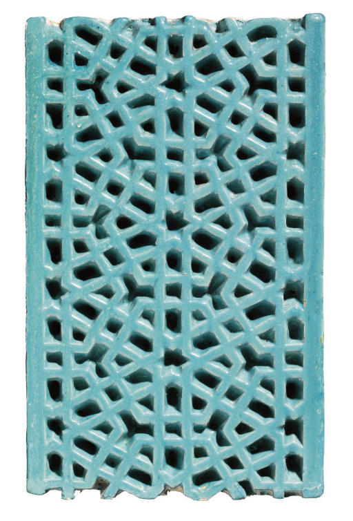 A TIMURID CARVED POTTERY TILE