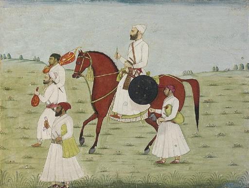 A MOUNTED NOBLEMAN WITH ATTEND