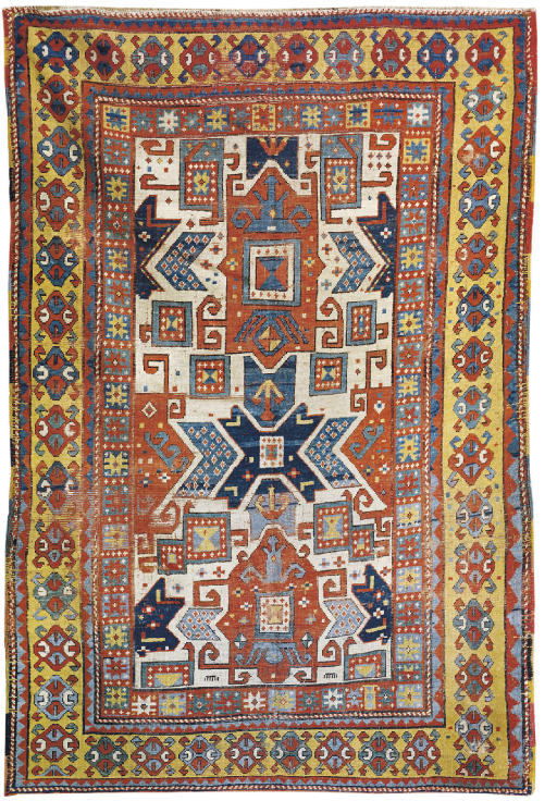 A WHITE GROUND STAR KAZAK RUG