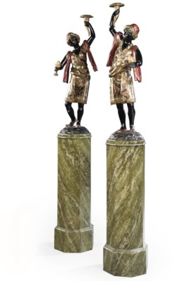 A PAIR OF GILT AND POLYCHROME-