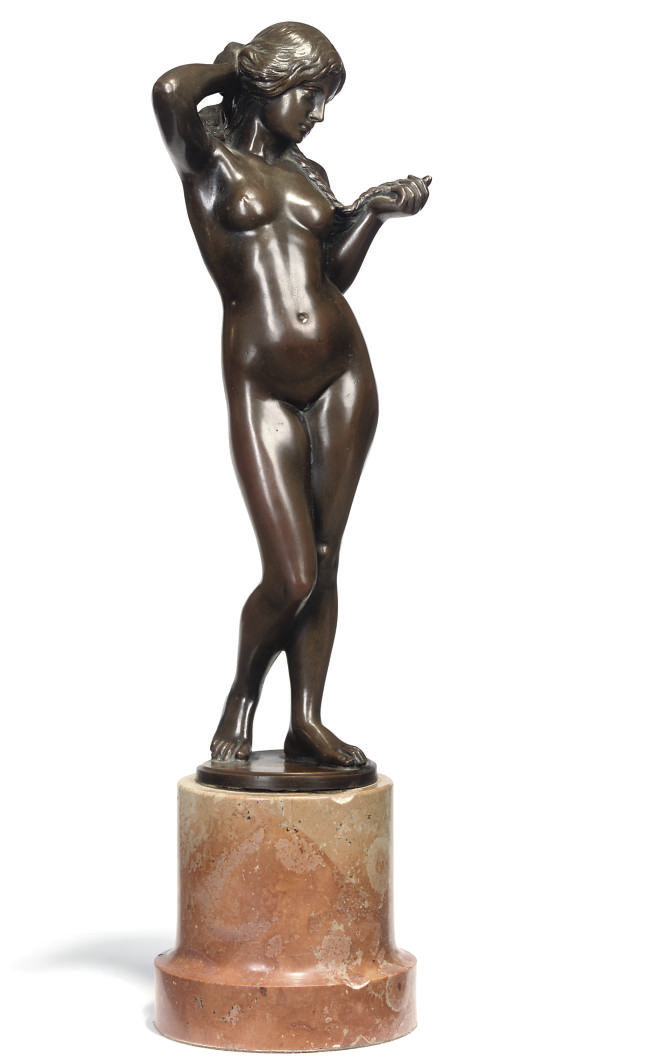A BRONZE PATINATED-METAL STATU