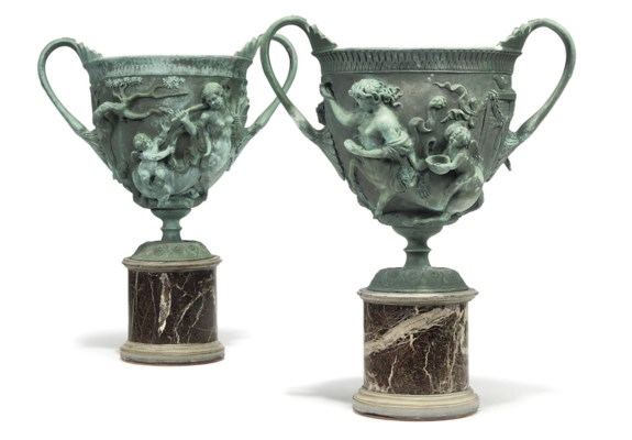 A PAIR OF BRONZE VASES ON MARB