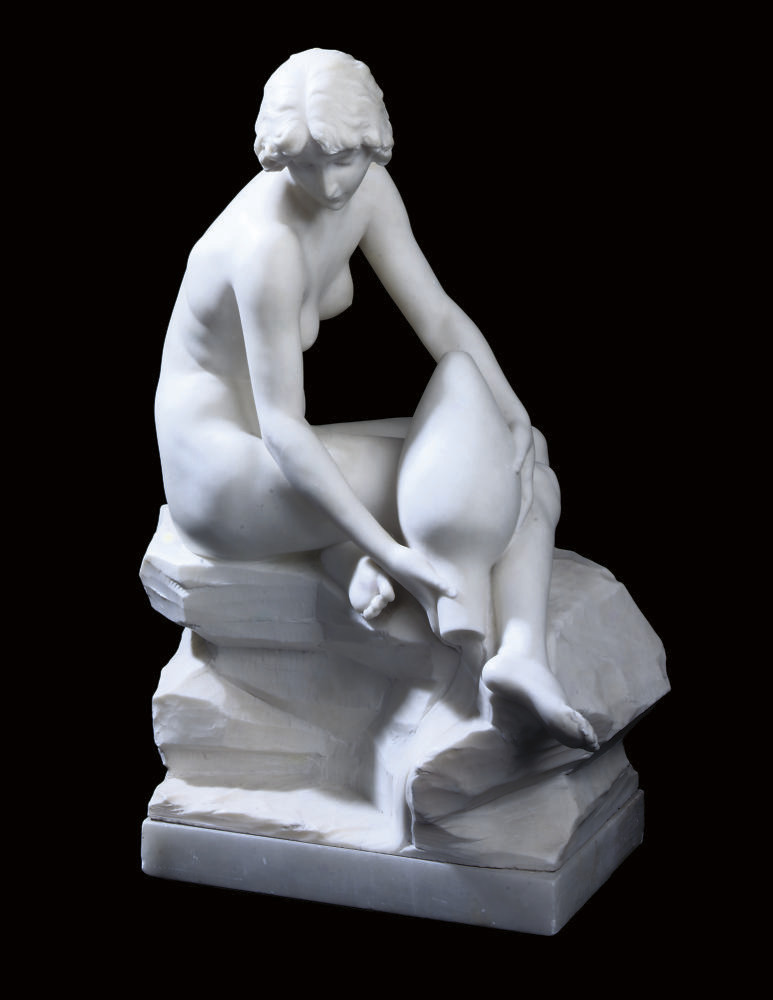 A WHITE MARBLE FIGURE OF A GIR