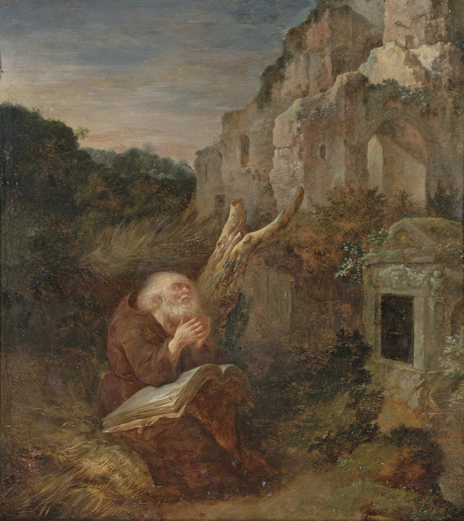 A hermit praying before a tomb, a landscape with ruins beyond