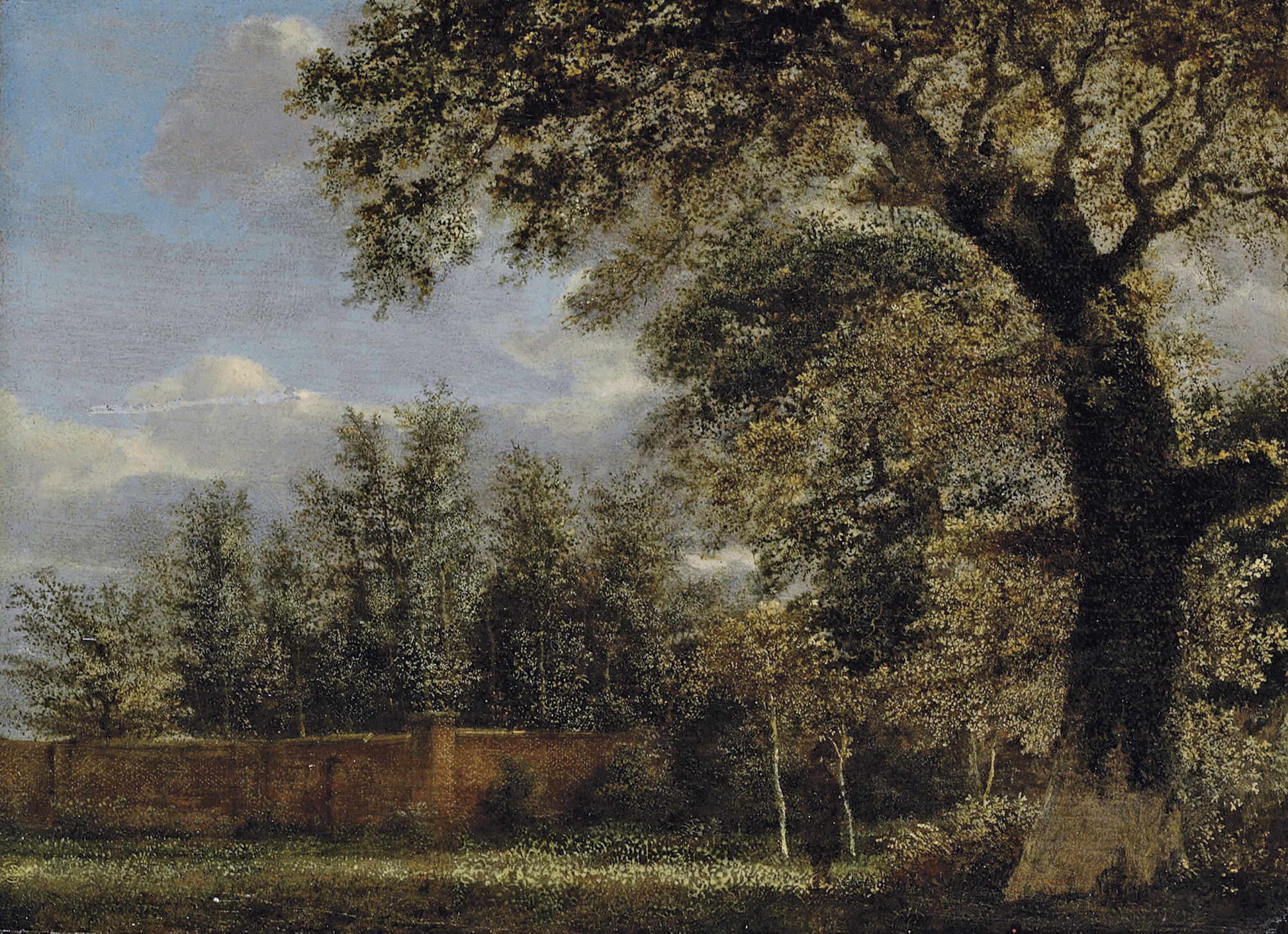 A wooded landscape with a figure in a park