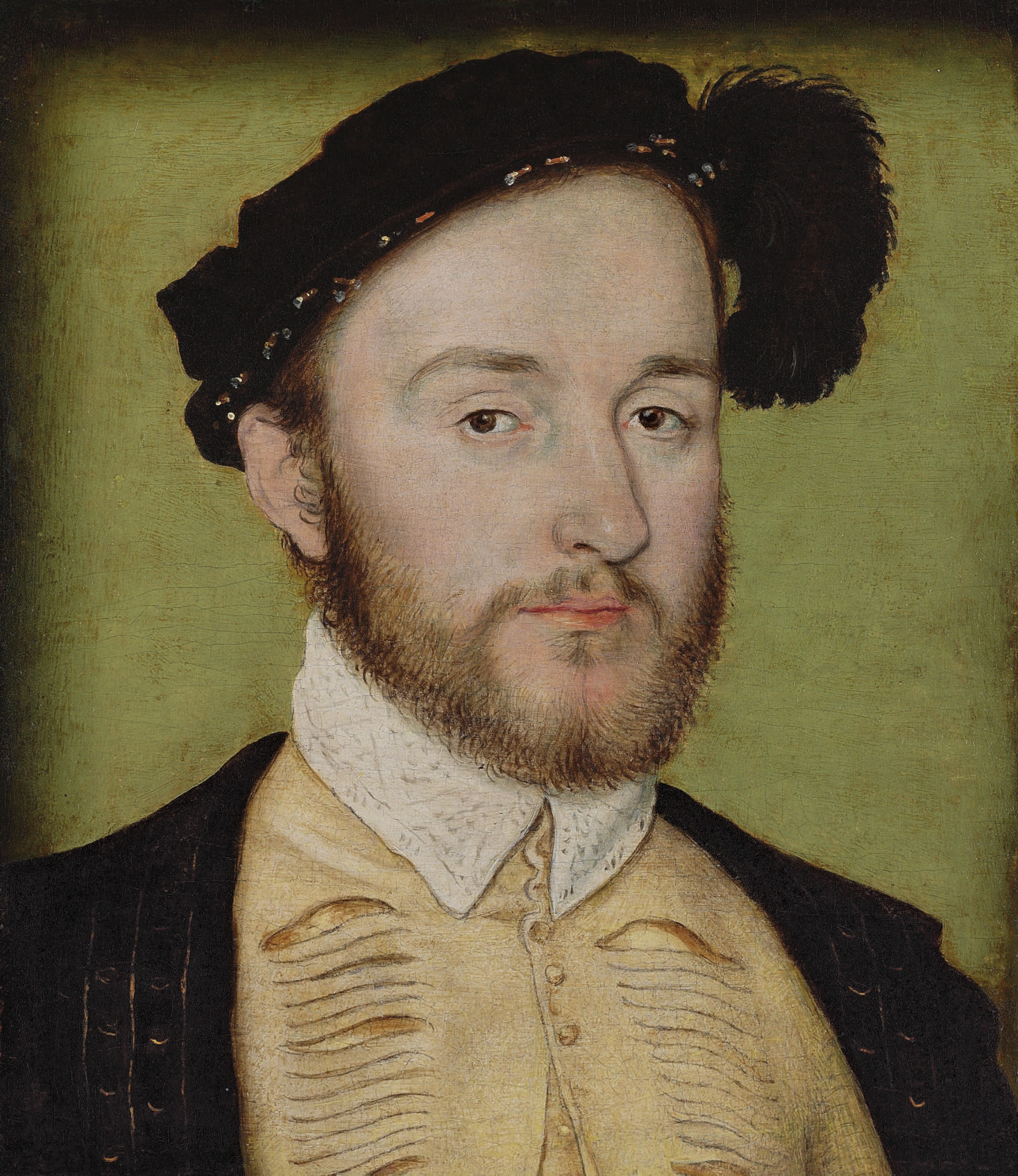 Portrait of Charles de la Rochefoucauld (1525-1562), seigneur de Randan, bust-length, in a slashed doublet, black coat and feathered cap