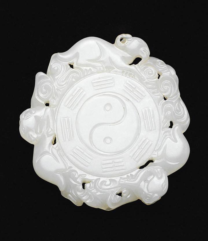 A WHITE JADE CIRCULAR PENDANT