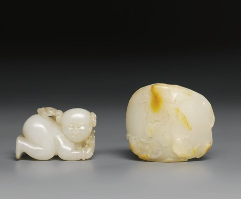 A SMALL WHITE JADE MODEL OF A
