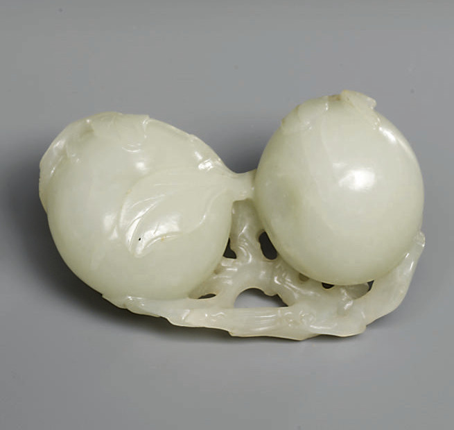 A WHITE JADE POMEGRANATE CARVI
