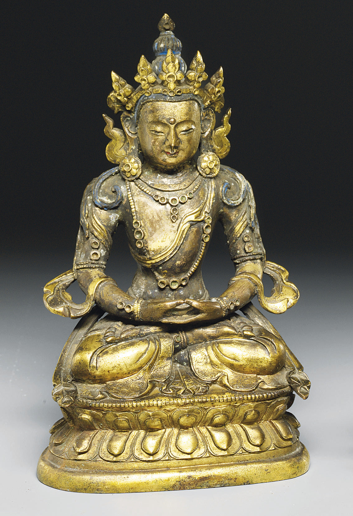 A GILT-BRONZE FIGURE OF A SEAT