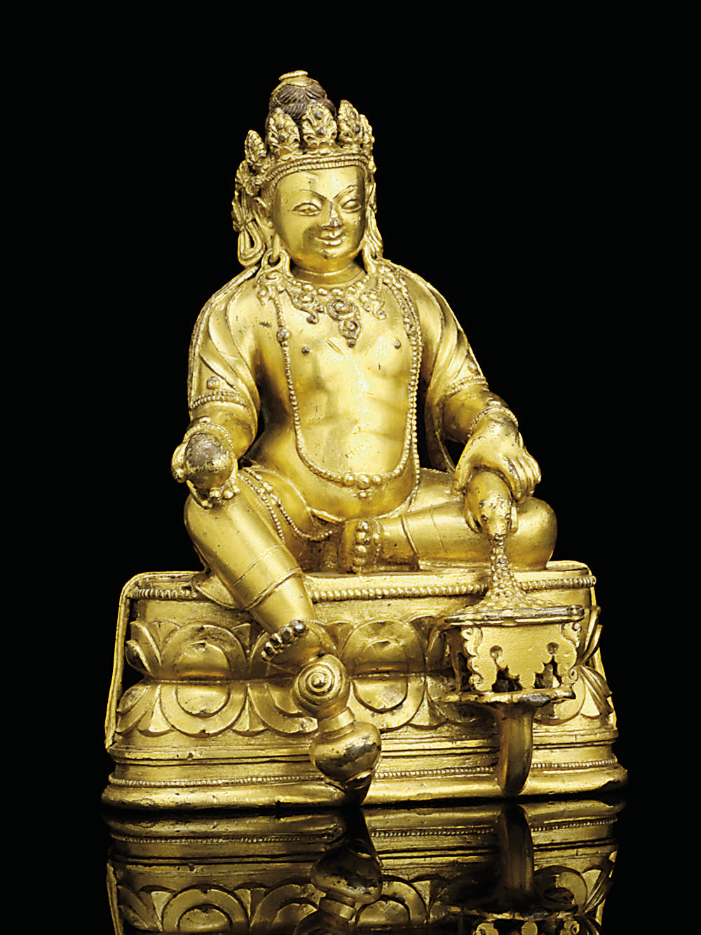 A MONGOLIAN GILT-BRONZE FIGURE