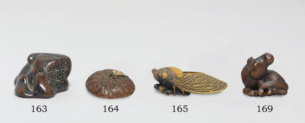 A WOOD NETSUKE AND TWO IVORY N