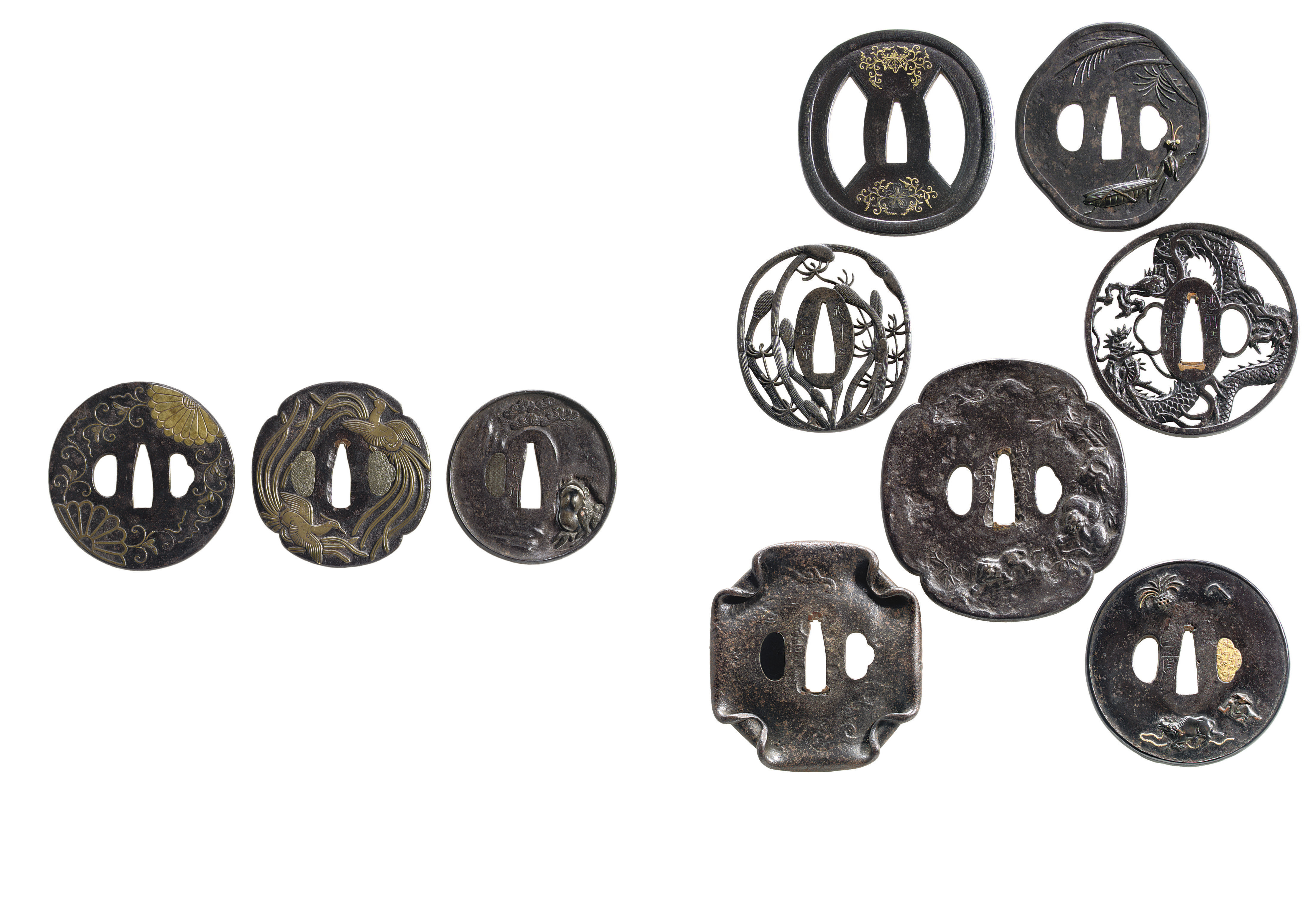 TWENTY-EIGHT IRON TSUBA