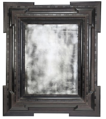 A FLEMISH EBONISED MIRROR
